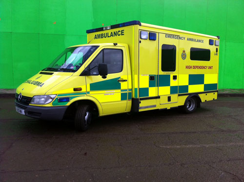 Side view of the private ambulance shown here against pinewood studions green screen